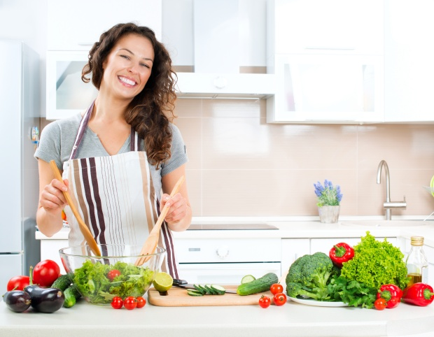 Eating plain salad greens isn't necessarily as easy and fun as this woman's huge grin would make you believe.
